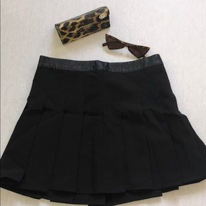 Black pleated tennis skirt with leather waist. New